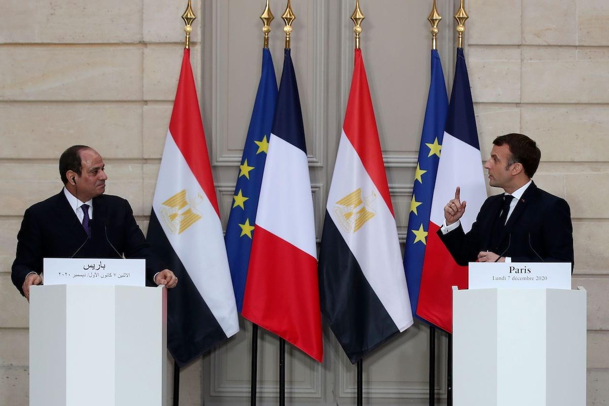 French President Emmanuel Macron (R) and his Egyptian counterpart Abdel Fattah al-Sisi (L) hold a press conference following their meeting at the Elysee presidential Palace on 7 December 2020 in Paris [MICHEL EULER/POOL/AFP via Getty Images]