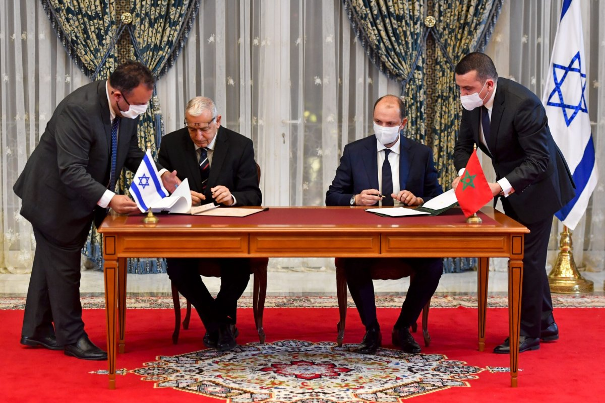 TOPSHOT - Director General of Israel's Population and Immigration Agency Shlomo Mor-Yosef (L) and Minister Delegate to Morocco's Minister for Foreign Affairs Mohcine Jazouli sign an agreement at the Royal Palace in the Moroccan capital Rabat on December 22, 2020, on the first Israel-Morocco direct commercial flight, marking the latest US-brokered diplomatic normalisation deal between the Jewish state and an Arab country. (Photo by FADEL SENNA / AFP) (Photo by FADEL SENNA/AFP via Getty Images)