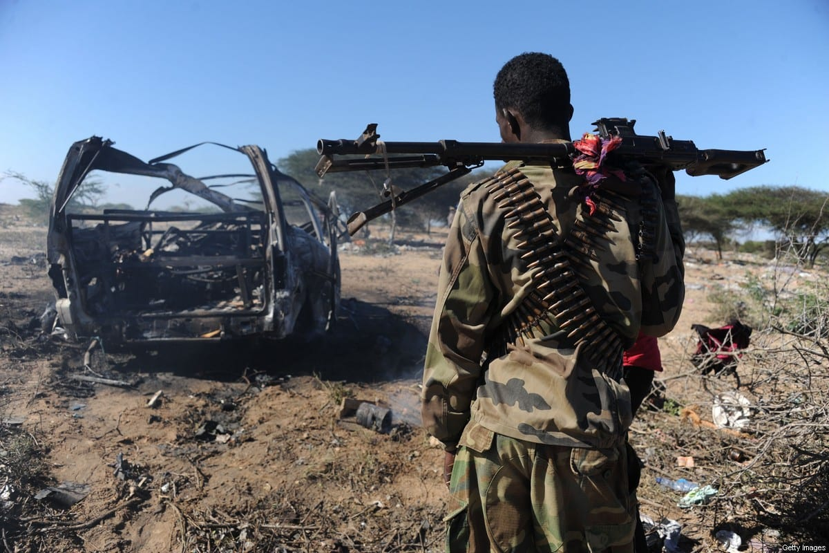 A soldiers checks the area where a suicide bomb attack took place in Mogadishu, Somalia on 6 December 2020 [Mohamed Abdiwahab/AFP/Getty Images]