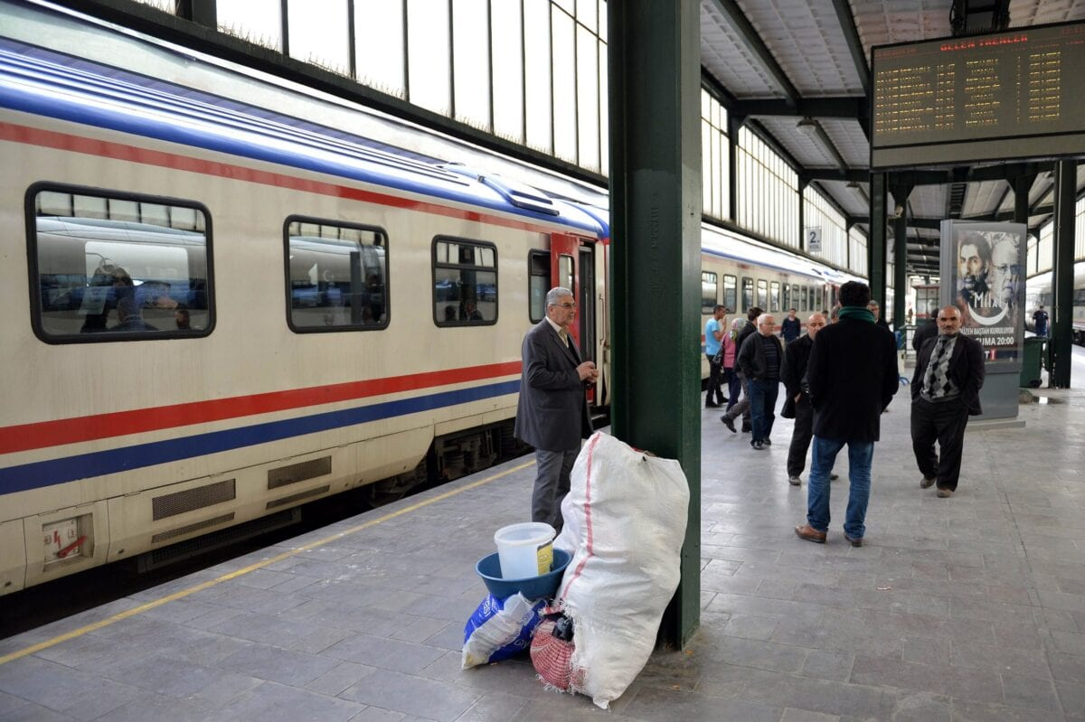 People wait on a platform at a train station in Ankara on March 31, 2015 [-/AFP via Getty Images]