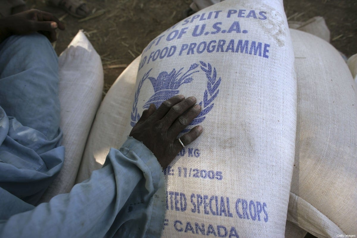 Bags of wheat are handed out during the first food distribution service on November 19, 2006 [Marco Di Lauro/Getty Images]