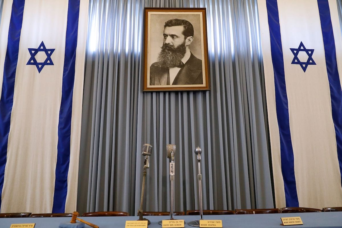 """A portrait of Theodor Herzl, the late founder of political Zionism, adorning the building of """"The Independence Hall Museum"""", the house in Tel Aviv where David Ben-Gurion, Israel's first prime minister, declared the creation of Israel 70 years ago on 3 May 2018. [JACK GUEZ/AFP via Getty Images]"""