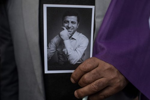 A supporter of the Pro-Kurdish Peoples' Democratic Party (HDP) holds a picture of Selahattin Demirtas on May 4, 2018 in Istanbul, Turkey [Chris McGrath/Getty Images]