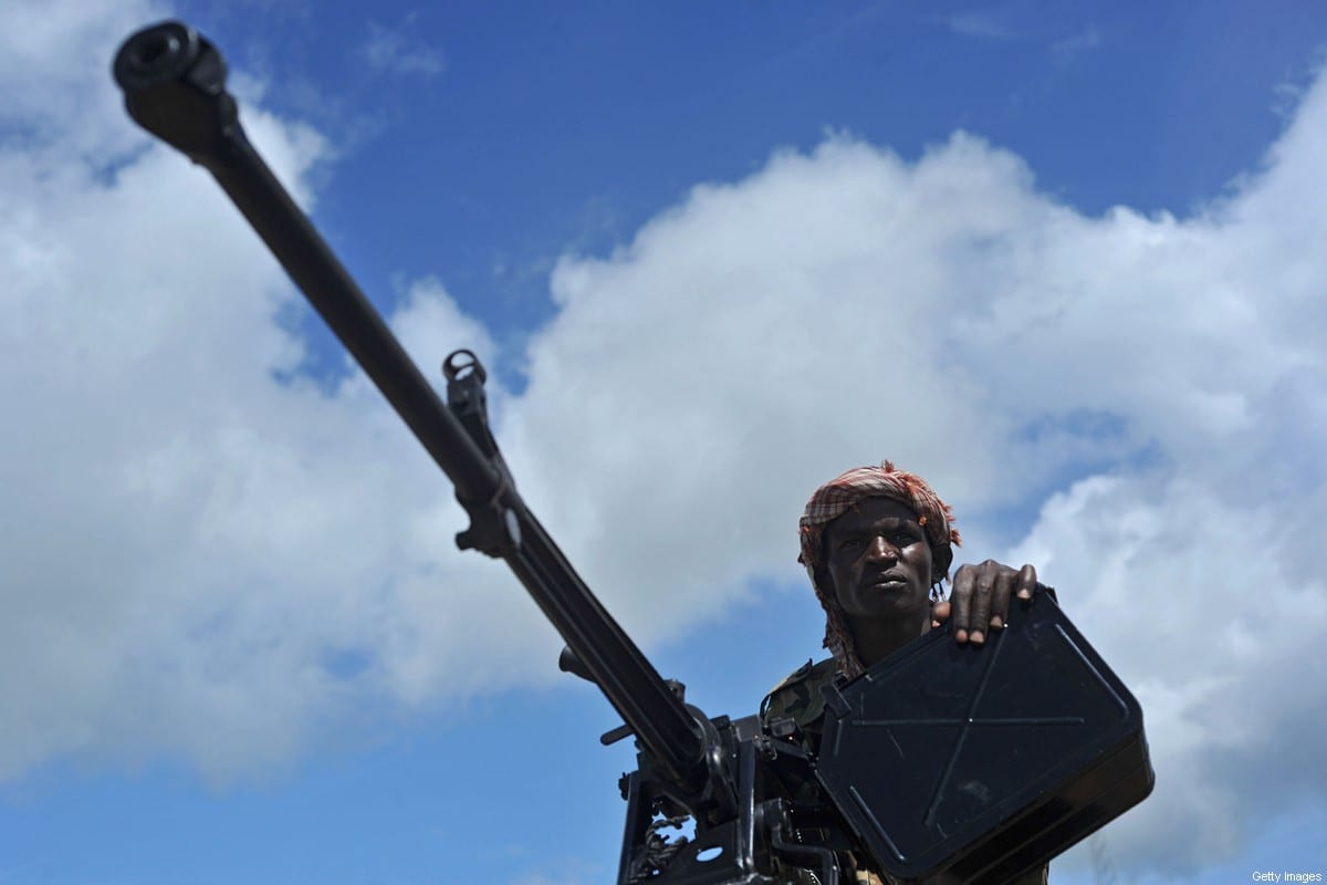 A Somali soldier holds a machine gun in Mogadishu, Somalia, on 13 June 2018 [MOHAMED ABDIWAHAB/AFP/Getty Images]