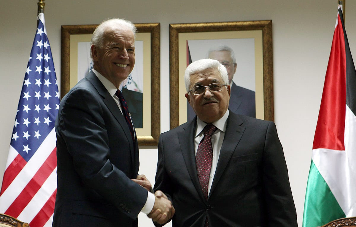 Then US Vice President Joe Biden (L) and Palestinian President Mahmoud Abbas shake hands during their meeting at the Presidential compound on March 10, 2010 in Ramallah, West Bank [Atef Safadi/Pool/Getty Images]