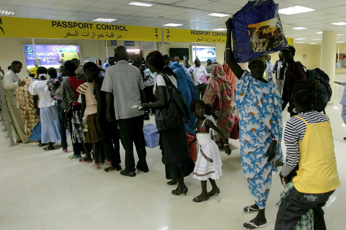Sudanese queue at passport control at an the airport in Khartoum, Sudan on 14 May 2012 [ASHRAF SHAZLY/AFP/GettyImages]