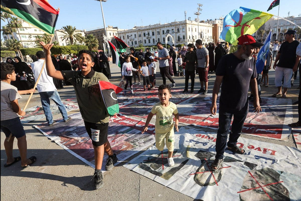 Children wave flags of Libya and the Amazigh on June 21, 2020 [MAHMUD TURKIA/AFP via Getty Images]
