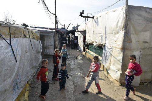 Syrian refugee are seen in a refugee camp in Tripoli, Lebanon on 3 January 2021 [Mahmut Geldi/Anadolu Agency]