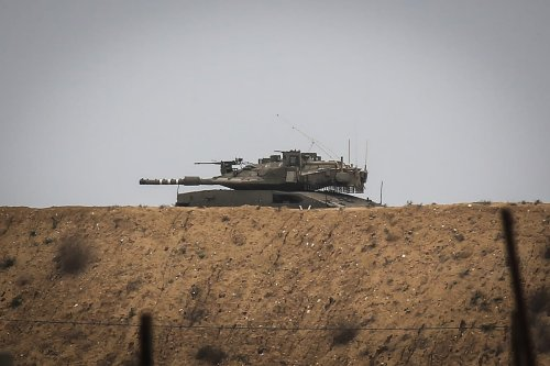 An Israeli tank near Gaza on 13 January 2021 [Ali Jadallah/Anadolu Agency]