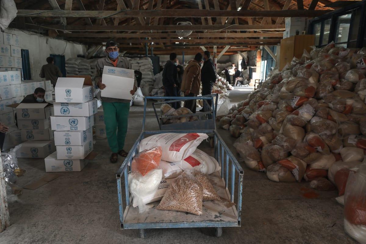 GAZA CITY, GAZA - JANUARY 14: Workers of United Nations Palestine Refugee Agency (UNRWA) prepare aids distribute to Palestinian refugees in Al-Shati Camp in Gaza City, Gaza on January 14, 2020. ( Ali Jadallah - Anadolu Agency )