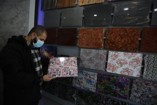 Gaza has got its first immersion printing service with Palestinian Omar Al-Asouli hoping to help people personalise their possessions and make them unique, in Gaza Strip on 4 January 2021 [Mohammed Asad/Middle East Monitor]