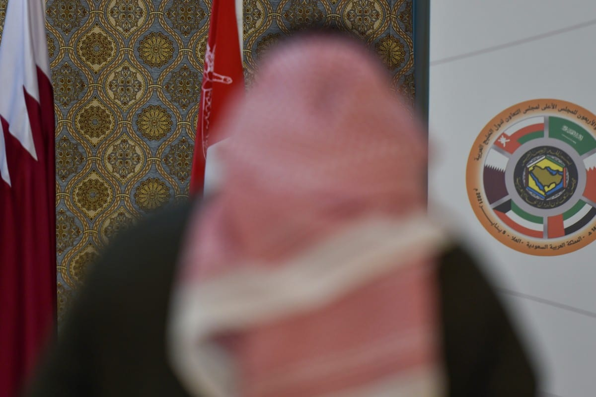 Gulf Cooperation Council (GCC) and the Qatari national flag ahead of the 41st summit in Al-Ula, Saudi Arabia on 5 January 2021 [FAYEZ NURELDINE/AFP/Getty Images)