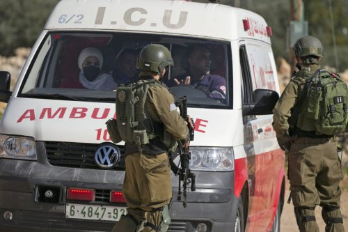 Israeli soldiers stop an ambulance amid clashes with Palestinian protesters following a demonstration against the expansion of settlements in the town of Salfit, in the Israeli-occupied West Bank, on December 4, 2020. (Photo by JAAFAR ASHTIYEH / AFP) (Photo by JAAFAR ASHTIYEH/AFP via Getty Images)