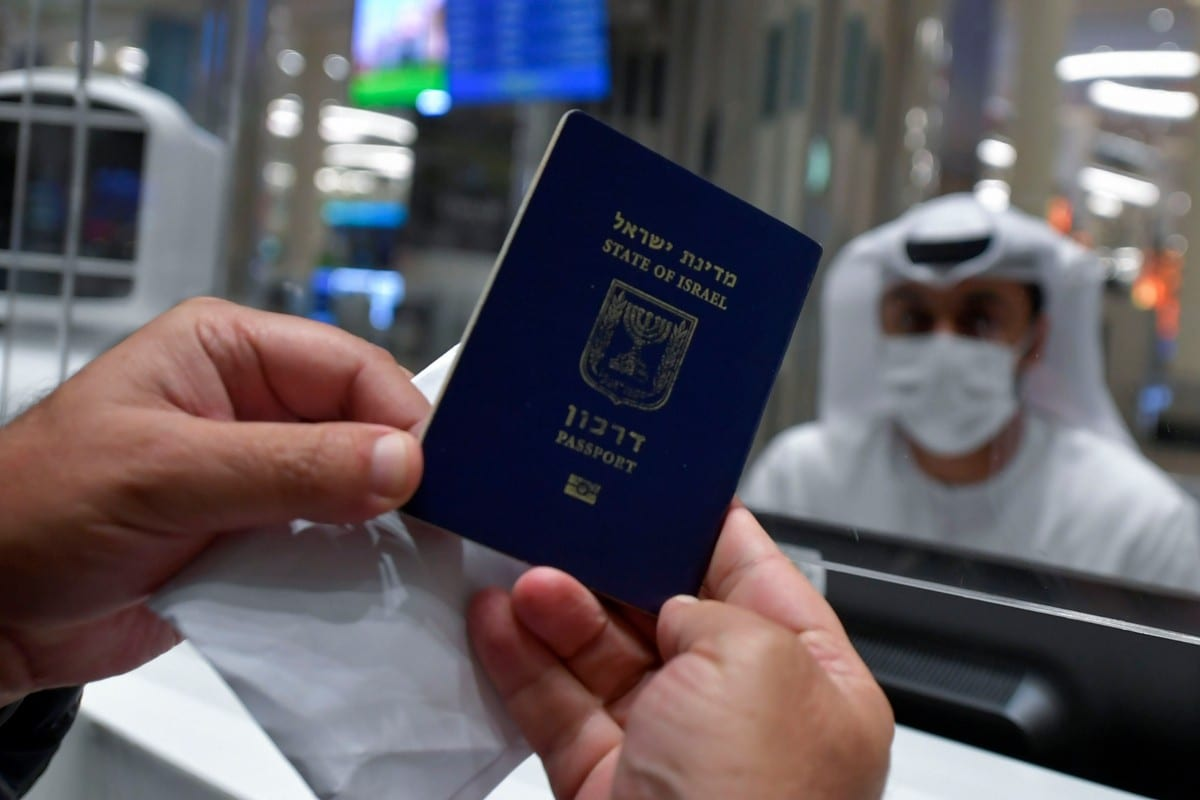An Israeli man presents his passport for control upon arrival from Tel Aviv to the Dubai, UAE on 26 November 2020 [KARIM SAHIB/AFP/Getty Images]
