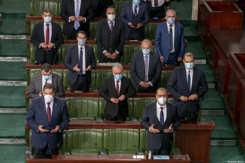 Tunisian Prime Minister Hichem Michichi (front R) attends the session of a confidence vote on the new government reshuffle at the Tunisian Assembly (parliament) headquarters in the capital Tunis, Tunisia on January 26, 2021 [Yassine Gaidi/Anadolu Agency]