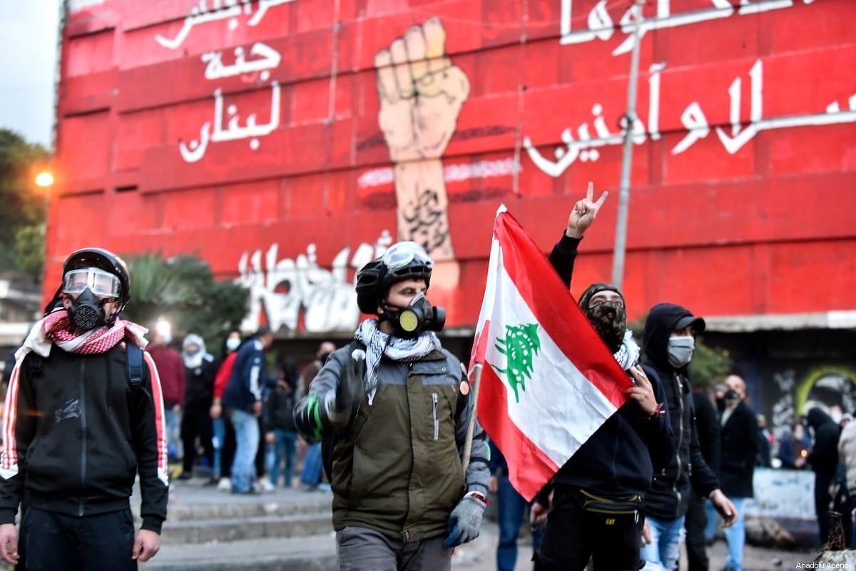Lebanese people protest against coronavirus (Covid-19) lockdown in Tripoli, Lebanon on January 27, 2021 [Houssam Shbaro/Anadolu Agency]