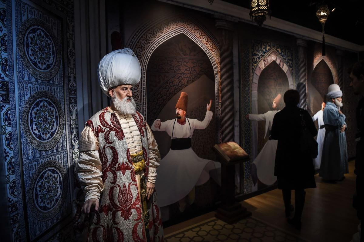 A visitor stands next to a wax statues of Ottoman ruler Suleiman the Magnificent (L) in the new branch of the iconic waxwork franchise Madame Tussauds in the centre of Istanbu [OZAN KOSE/AFP via Getty Images]