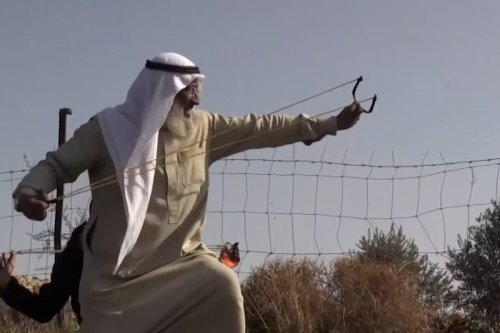 Thumbnail - Elderly Palestinian man resisting Israel's occupation with a slingshot