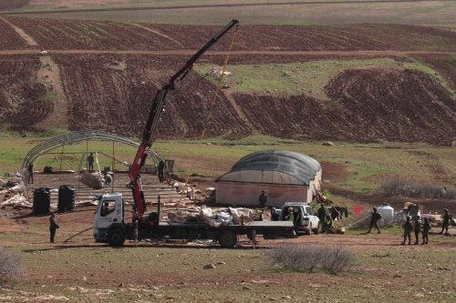 Israeli army demolishes nearly 40 tents and structures of Palestinians in Himsa al-Bakia, in an area east of the Palestinian village of Tubas, in the occupied West Bank, on 1 February 2021. [Nedal Eshtayah - Anadolu Agency]