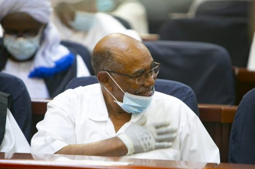 Sudan's ousted president Omar al-Bashir appears during his tria in Khartoum on February 02, 2021 [Mahmoud Hjaj/Anadolu Agency]