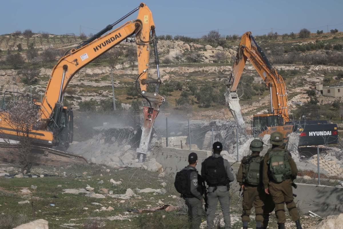Israeli forces demolish a house belonging to a Palestinian family in Hebron, West Bank on 3 February 2021 [Mamoun Wazwaz/Anadolu Agency]