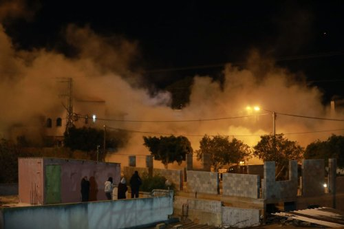 Smoke rises as Israeli forces demolish the home of Palestinian prisoner Mohammed Meruh Kabha, who was accused of killing a Jewish settler in Tura town of Jenin, West Bank to on 10 February 2021.[ Issam Rimawi - Anadolu Agency]
