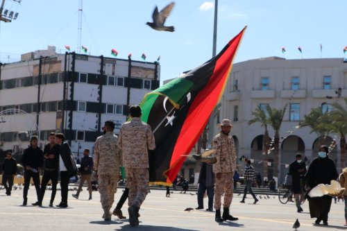Libyans holding flags celebrate the 10th anniversary of Libyans' February 17 Revolution which put an end to 42 years of Muammar Gaddafi dictatorship in 2011 at Martyrs' Square in Tripoli, Libya on 16 February 2021. [Mücahit Aydemir - Anadolu Agency]