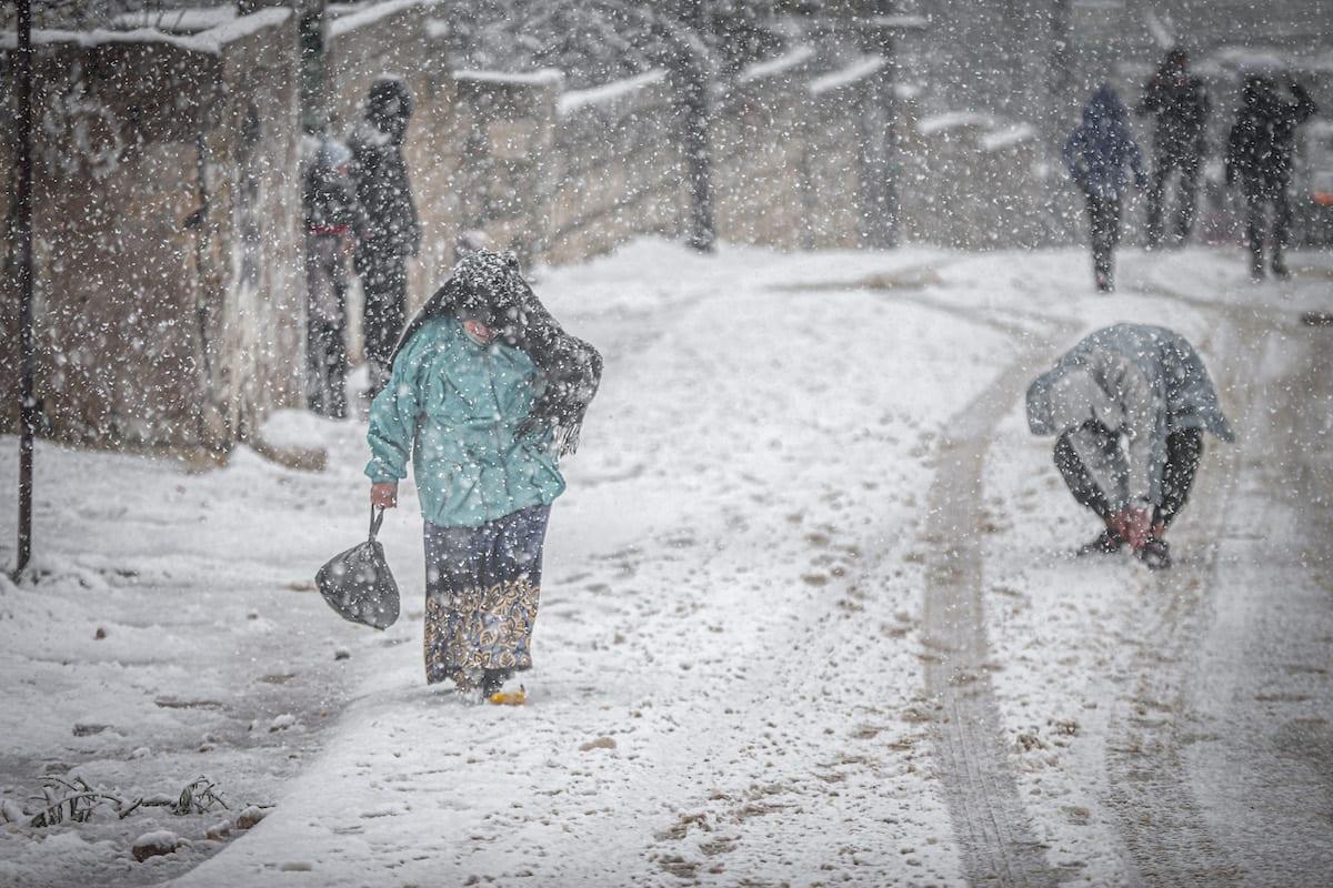 Syrians seen during a harsh winter in Idlib, Syria on 17 February 2021 [Muhammed Said/Anadolu Agency]