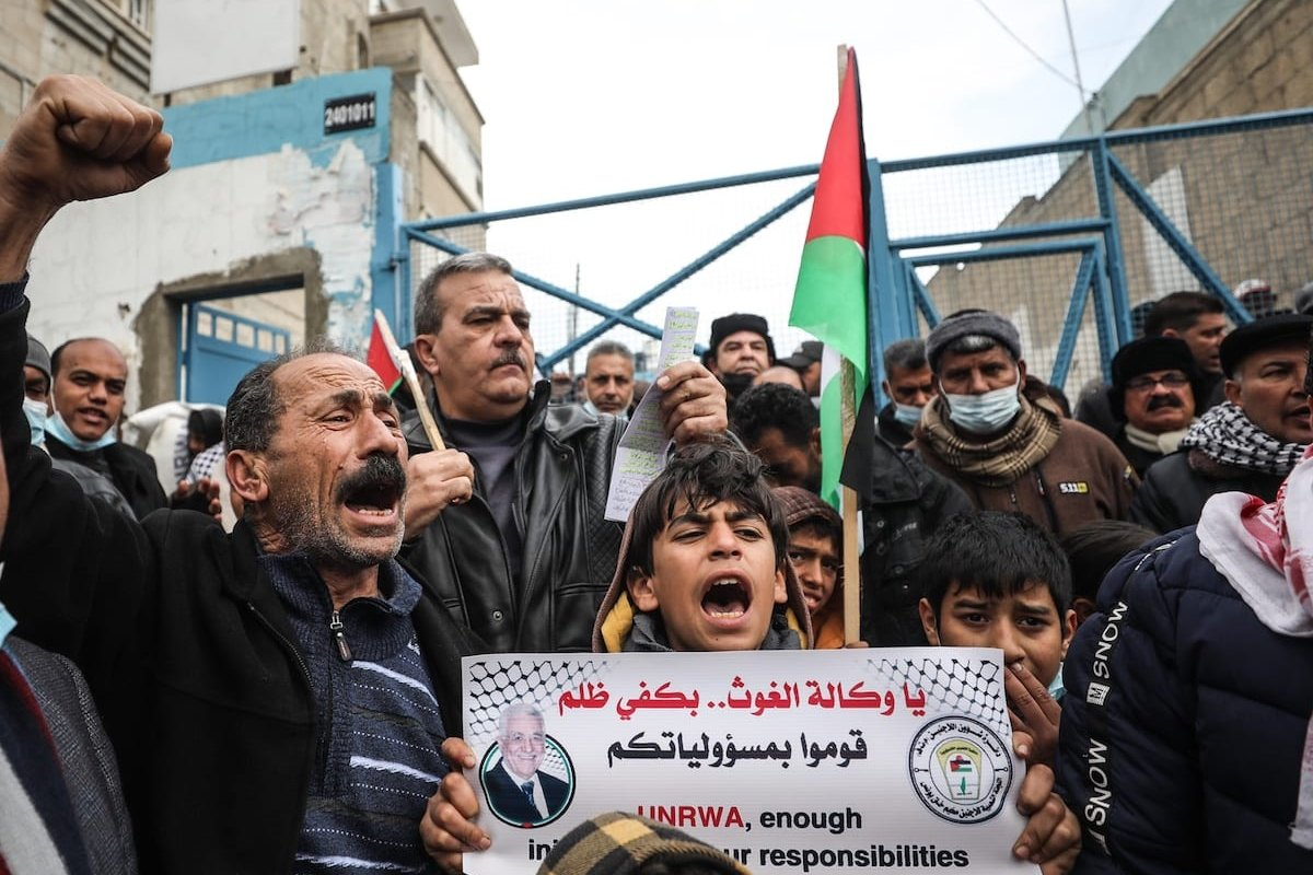 Palestinians gather in front of United Nations Relief and Works Agency (UNRWA) building to stage a protest against food aid reduction by the UNRWA in Khan Yunis, Gaza on 23 February 2021. [Mustafa Hassona - Anadolu Agency]