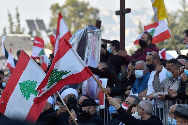 Lebanese protesters wait for the speech of Lebanon's Cardinal Bechara Boutros Al-Rai at the Maronite Patriarchate in the mountain village of Bkerki, northeast of Beirut, Lebanon on February 27, 2021 [Houssam Shbaro / Anadolu Agency]