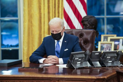 US President Joe Biden signs executive actions in the Oval Office of the White House in Washington, DC, US, on Tuesday, 2 Feb. 2021. [Doug Mills/The New York Times/Bloomberg]