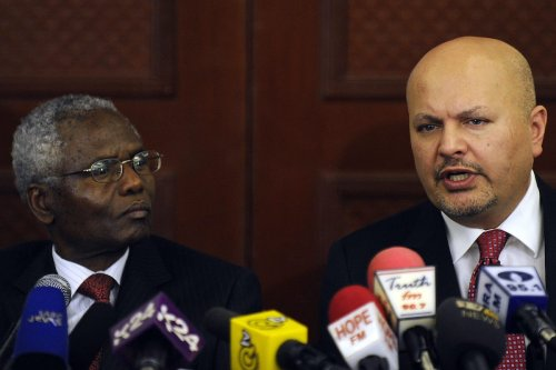 ICC new chief prosecutor Karim Khan (R) during a press conference in Nairobi on March 13, 2013 [TONY KARUMBA/AFP via Getty Images]
