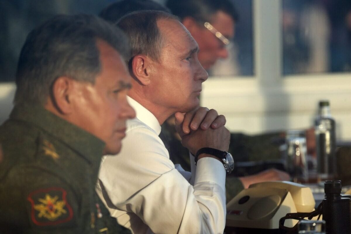 Russian President Vladimir Putin (C) and Defense Minister Sergei Shoigu (L) are watching Russias large-scale Center-2015 military exercises on September 19, 2015 [Sasha Mordovets/Getty Images]
