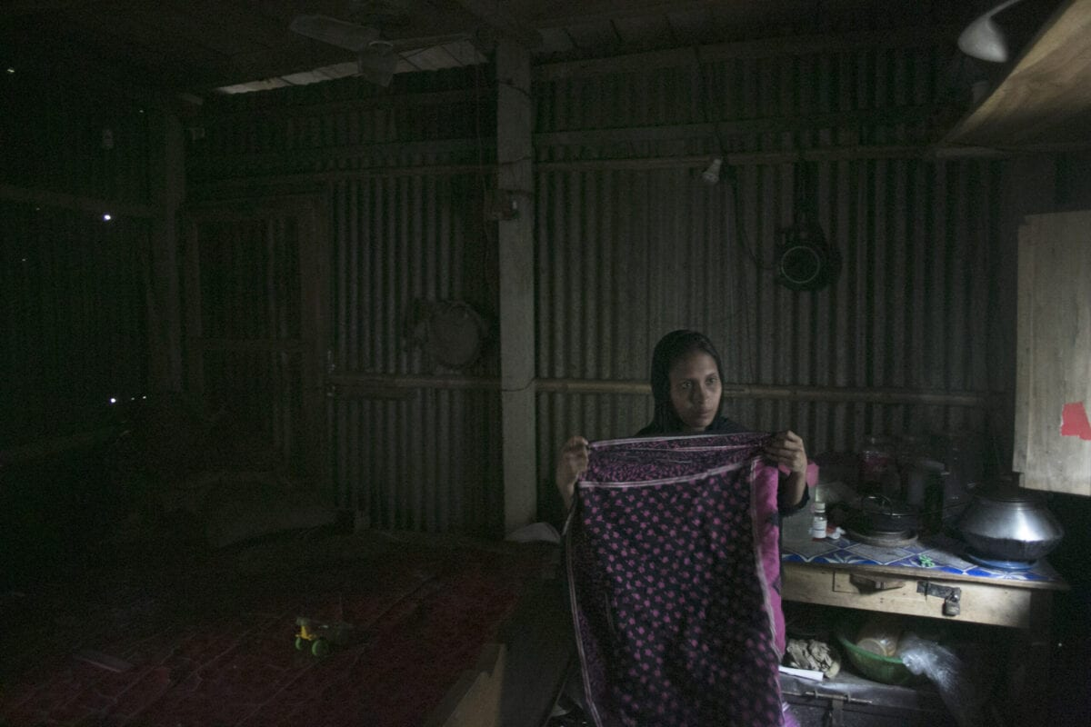 28 year old Reyhana Begum, who is preparing to work as a housekeeper in Saudi Arabia, folds clothes in her home March 14, 2016 in Dhaka, Bangladesh [Allison Joyce/Getty Images]