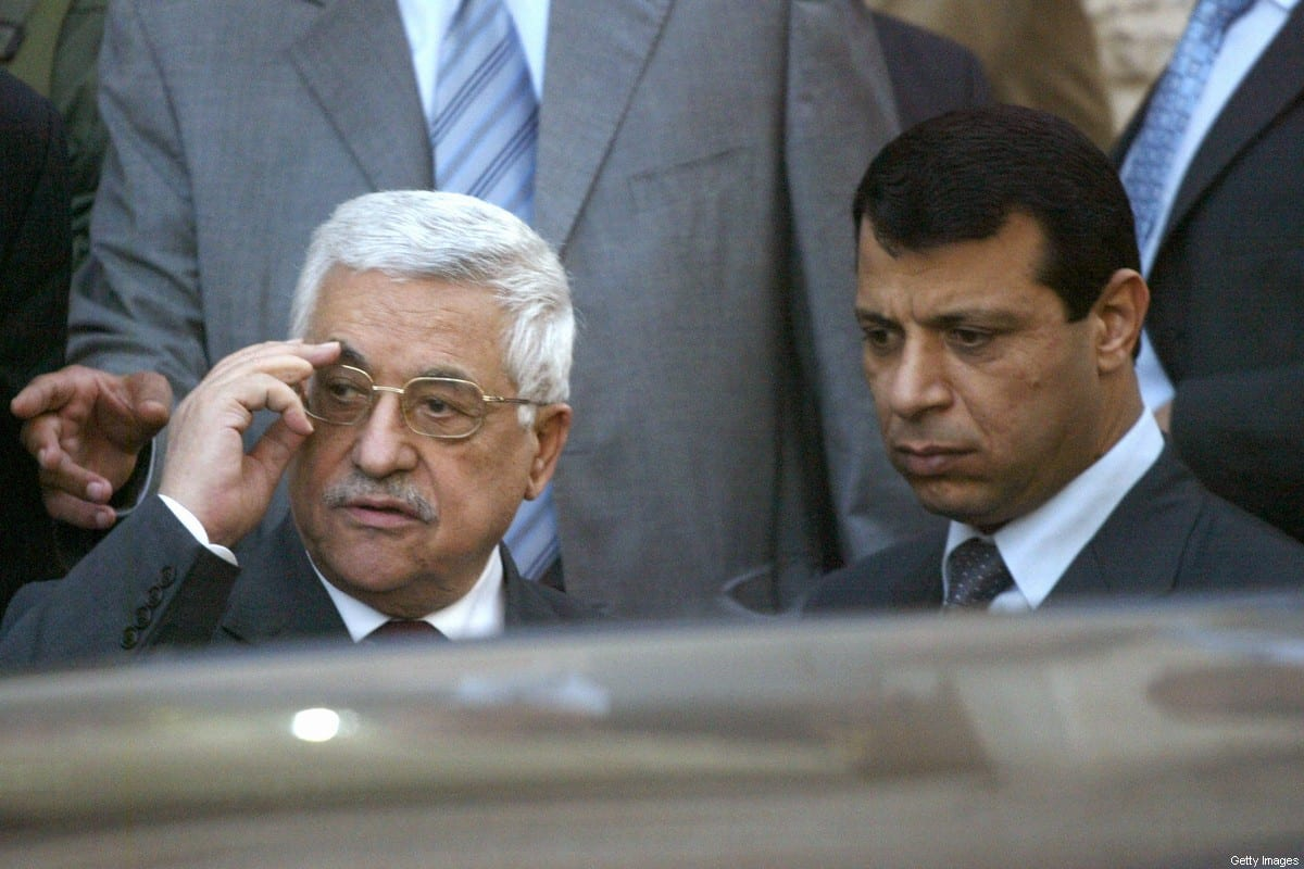 Palestinian President Mahmud Abbas (L) stands with Mohammad Dahlan, a strongman from the Fatah party in Ramallah, 25 March 2007 [JAMAL ARURI/AFP via Getty Images]