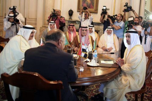 """Bahraini Foreign Minister Khalid bin Ahmed al-Khalifa (L), Egyptian Foreign Minister Sameh Shoukry (C-L), Saudi Foreign Minister Adel al-Jubeir (C-R), and UAE Minister of Foreign Affairs and International Cooperation Abdullah bin Zayed Al-Nahyan (R) meet in the Egyptian capital Cairo on July 5, 2017, to discuss the Gulf diplomatic crisis with Qatar, as Doha called for dialogue to resolve the dispute. The Saudi foreign ministry said on July 5, 2017 that it had received Qatar's response to a 13-point list of demands issued on June 22 -- which include Doha ending support for the Muslim Brotherhood and closing broadcaster Al-Jazeera -- and would respond """"at the right time"""". / AFP PHOTO / POOL / Khaled ELFIQI (Photo credit should read KHALED ELFIQI/AFP via Getty Images)"""