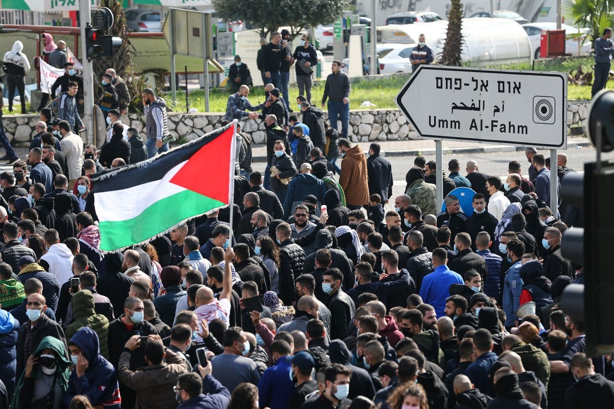 Israeli Arabs march to protest against the raise in crime and violence after performing the Friday prayer outside the municipality building in Umm al-Fahm, Israel, on 5 February 2021. [Mostafa Alkharouf - Anadolu Agency]