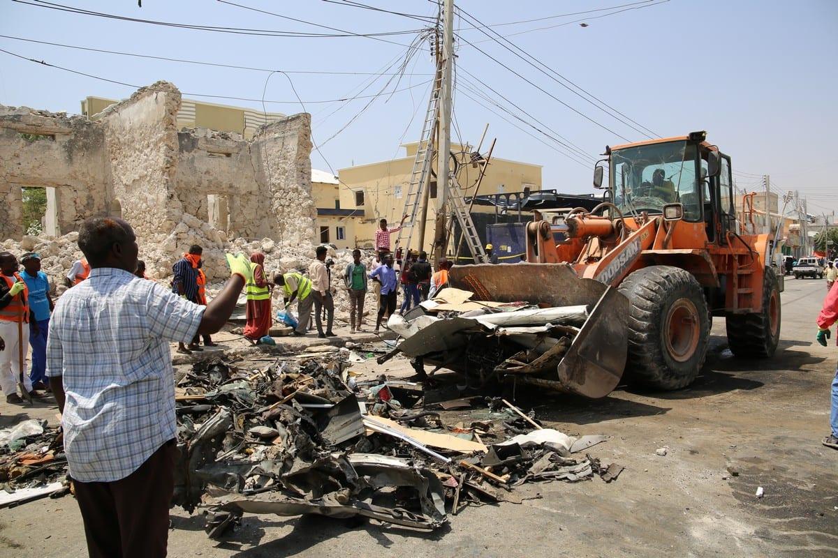 A heavy machine removes the wreckage following a car bomb blast in Mogadishu, Somalia on 13 February 2021 [Sadak Mohamed/Anadolu Agency]