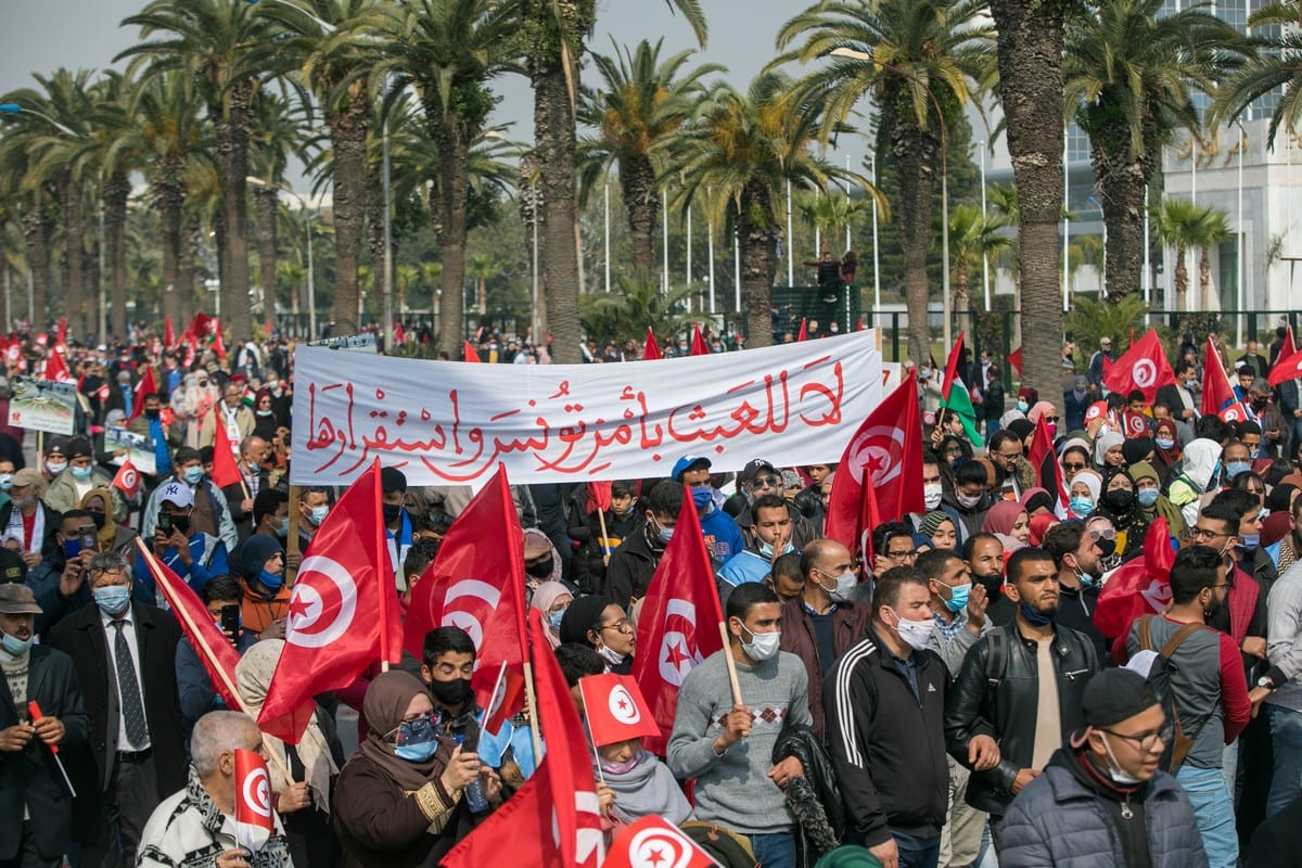 Supporters of the Ennahda party rally to demand the end of political crisis in the country as the rift bteween the President of Tunisia, Kais Saied and Prime Minister Hichem Mechichi continues, in Tunis, Tunisia, on February 27, 2021 [Nacer Talel / Anadolu Agency]