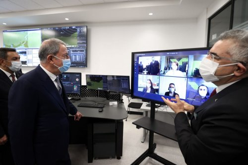 Turkish Defense Minister Hulusi Akar (C) is being briefed during his visit to make inspections at HAVELSAN, a Turkish software and systems company having business presence in the defence and IT sectors, in Ankara, Turkey on 27 February 2021. [Arif Akdoğan - Anadolu Agency]