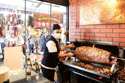 A man prepares food at a restaurant with the new controlled normalization process in Istanbul, Turkey on March 02, 2021 [İslam Yakut/Anadolu Agency]