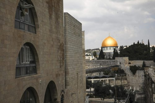 People are seen during their daily lives near Masjid Al-Aqsa in Jerusalem on February 24, 2021 [Mostafa Alkharouf/Anadolu Agency]
