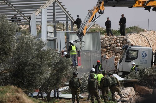 Israeli forces demolish allegedly unauthorized houses belonging to three different Palestinian families in Hebron, West Bank on 2 March 2021. Israeli forces left 12 Palestinians homeless. [Mamoun Wazwaz - Anadolu Agency]