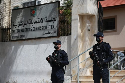 Security measures are taken in front of Central Election Commission building after Palestinian authorities on Saturday opened registration for the legislative elections, scheduled for 22 May in Gaza City, Gaza on March 20, 2021. [Mustafa Hassona - Anadolu Agency]