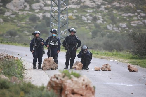 Israeli forces intervene in Palestinians on Al-Urme Hill against the seizure of Jewish settlers in Nablus, West Bank on 23 March 2021. [İssam Rimawi - Anadolu Agency]