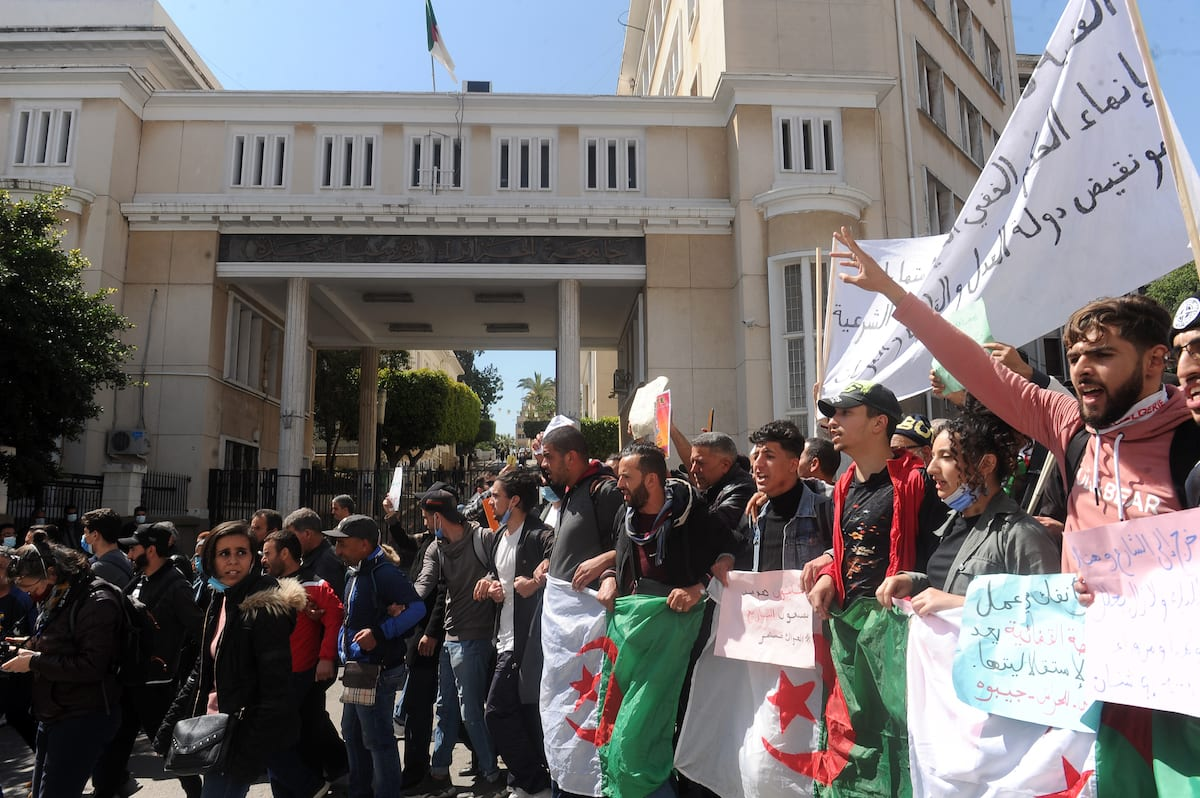 Algerian students stage a protest against Parliamentary elections scheduled for 12 June in Algiers, Algeria on 23 March 2021. Mousaab Rouibi - Anadolu Agency]