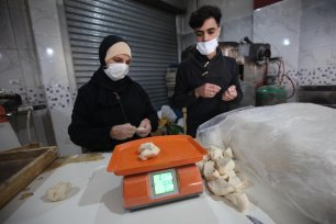Palestinian baker Ruba Abu Al-Aish on 5 March 2021 in Gaza [Mohammed Asad/Middle East Monitor]