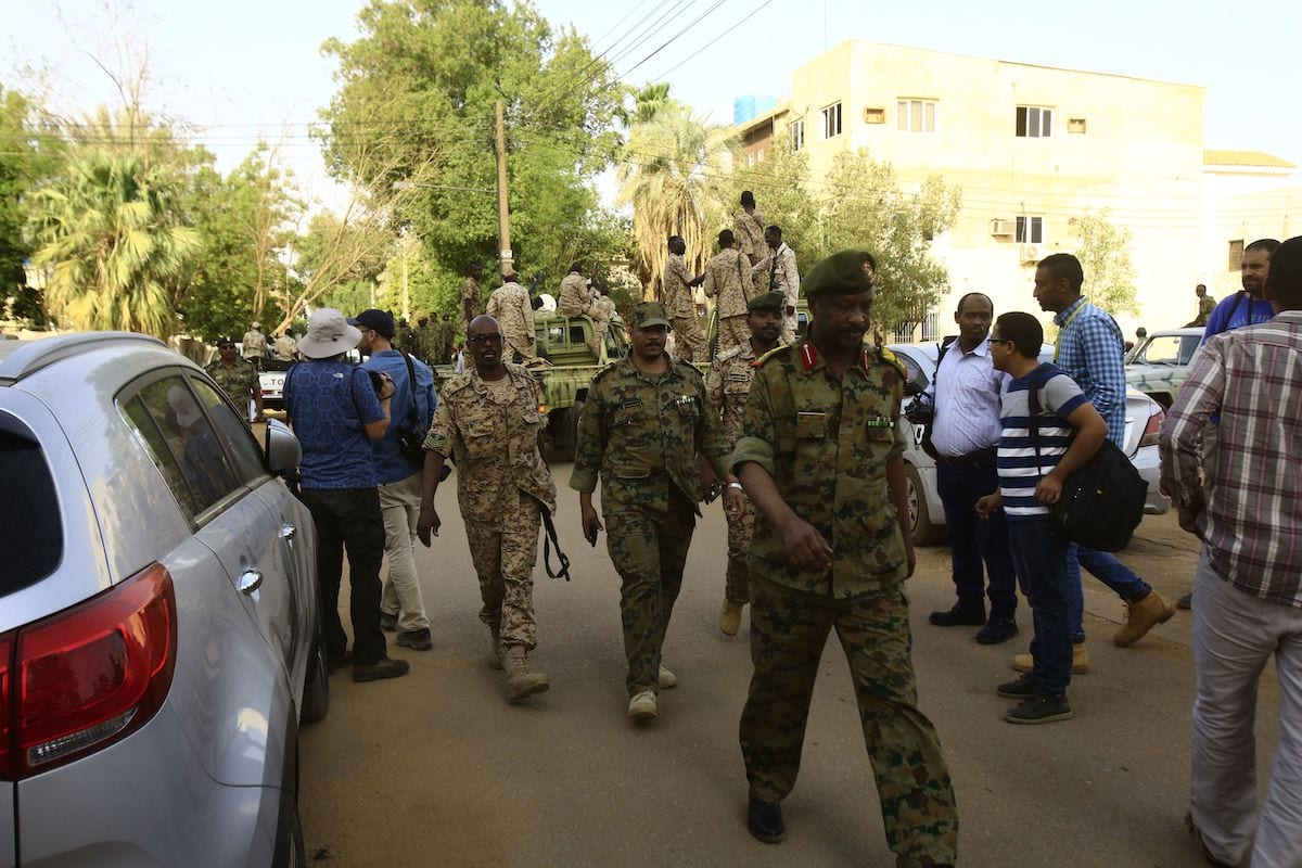 Sudanese uniformed officers walk outside the anti-corruption prosecution's offices in the capital Khartoum on 16 June 2019 [ASHRAF SHAZLY/AFP via Getty Images]