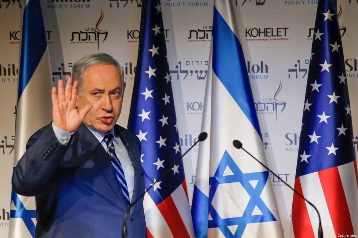 Isreali Prime Minister Benjamin Netanyahu waves as he attends the Kohelet Policy Forum conference in Jerusalem, on January 8, 2020 [MENAHEM KAHANA/AFP via Getty Images]
