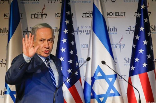 Isreali Prime Minister Benjamin Netanyahu waves as he attends the Kohelet Policy Forum conference in Jerusalem, on January 8, 2020 [MENAHEM KAHANA/AFP via Getty Images]